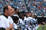 Head Coach Mike Mularkey stands next to offensive starters Blaine Gabbert and Maurice Jones-Drew during the national anthem.