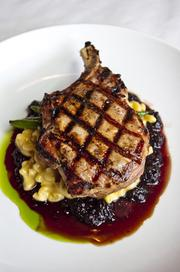Sweet-tea brined pork chop on macaroni gratin with warm blackberry ginger preserves.Subscribers can click here to see this month's Executive Eats profile on 29 SouthRestaurant.