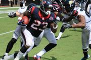 Linebacker Paul Posluszny and several Jaguars defenders stop Arian Foster for a short gain on third down.