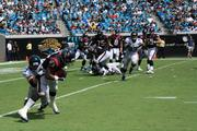 After running back Arian Foster catches a short pass, linebacker Paul Posluszny tackles him for a short game.