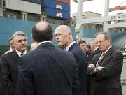 Jaxport CEO Paul Anderson, left Jaxport Chairman Dave Kulik, right listen to Florida Governor Rick Scott during a tour of the Trapac Terminal. The Governor was in town touring the area ports.