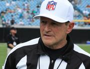 Referee Ed Hochuli.The NFL and referees ended their lockout Wednesday.