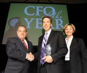 Jerry Baber (center), senior vice president and CFO of Union Station Kansas City, won the nonprofit organization category for CFO of the Year.