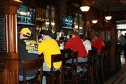 Missouri fans pass time in the Power & Light District's new Irish pub, The Dubliner.
