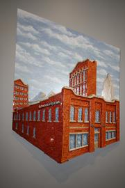 Two artistic portrayals of FishNet's former Kansas City headquarters are made from recycled computer chips.