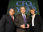 David Leavitt (center), CFO of the Year medium company category winner, is vice president and CFO of The Victor L. Phillips Co.