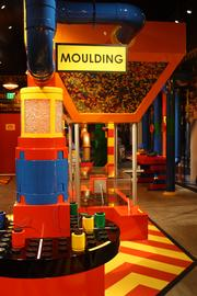 """In the first section of Legoland Discovery Center, kids can """"melt"""" plastic and """"mold"""" Legos."""