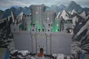 The push of a button makes the Wicked Witch melt on the castle portion of the Wizard of Oz section of Miniland at Legoland Discovery Center.
