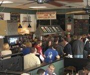 Customers congregate at Oklahoma Joe's in Kansas City, Kan.