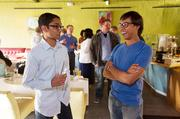 Ravi Patel (left), a Web specialist at Galleon Labs LLP, visits with Galleon CEO Riddhiman Das at Snow & Co.