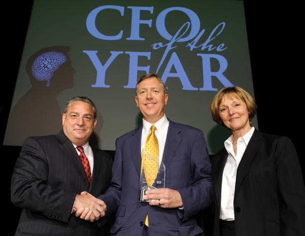 Michael Upchurch (center), executive vice president and CFO of Kansas City Southern, won the large company category for CFO of the Year.