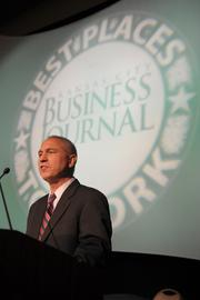 Brian Kaberline, editor of the Kansas City Business Journal, welcomes the crowd.