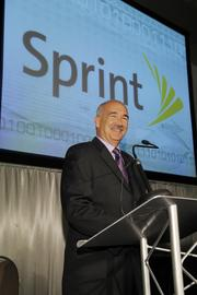 Scott Rice, IT vice president at Sprint Corp., congratulates all winners and participants. Sprint was a presenting partner of the event.