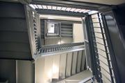 The staircase in the Ambassador is original, though architects added height to its railings for safety reasons.