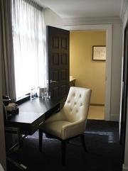 In some of the Ambassador Hotel's suites, the main bedroom is separate from another living area, office space and bathroom.