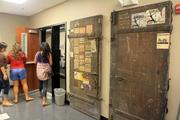 When clearing out the Lyric's former space, workers found these doors, which used to lead out to the alley. The stickers on the doors show the history of the performance space -- they're from past shows.
