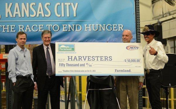 Mike Brown (left), president of Farmland Foods Inc.; Dan Weaver, Harvesters board member; George Richter, president of Smithfield Foods Inc.; and Richard Petty, NASCAR Hall of Famer
