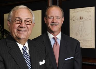 Tom Bowser (left) has turned over his title as CEO of Blue Cross and Blue Shield of Kansas City to David Gentile (right).