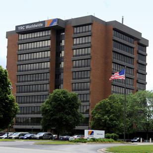 Standard & Poor's Ratings Services is downgrading its corporate credit rating for Overland Park-based YRC Worldwide after the company said it failed to meet a milestone in its restructuring plan.