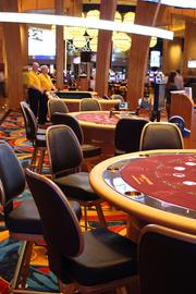 The casino has 52 table games, including poker tables in a separate area.