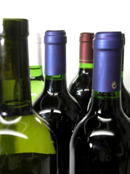 A bill that would allow grocery and convenience stores to sell wine, liquor and full-strength beer needs a longer phase-in period to receive legislative support, says a Wichita lawmaker.