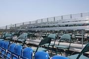 Kauffman Stadium employees have built two of these extra seating sections for reporters in town for the game. This one, located in the outfield, is elevated so people who purchased standing-room-only tickets can watch the game in front of it.