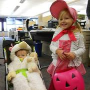 Hundreds of costumed children parade through Burns & McDonnell's halls, including Little Bo Peep and her sheep, as part of the company Halloween party.