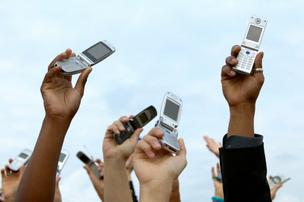Cellphones raised in the air, do not call list