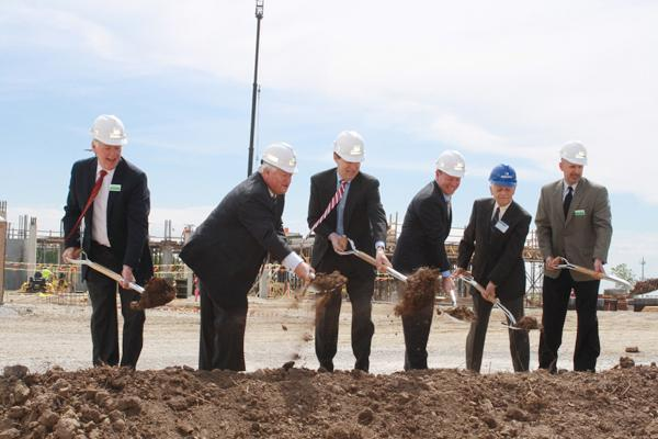 Dignitaries at Cerner Corp.'s groundbreaking ceremony in Kansas City, Kan., include Cliff Illig (second from left), co-founder and vice chairman; Kansas Gov. Sam Brownback; and Joe Reardon, mayor/CEO of the Unified Government of Wyandotte County/Kansas City, Kan.