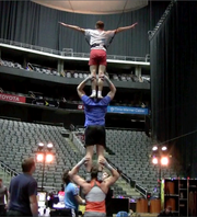 Performers use the harness for this stunt strictly in rehearsals; it comes off during the show.