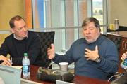 Perceptive Software CEO Scott Coons listens to Apple Inc. co-founder Steve Wozniak, who gave a surprise visit to Perceptive's Shawnee offices on Friday.