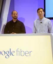 Dov Zimring and Larry Yang, members of GoogleFiber's product team, demonstrate the features of the new ultra-fast network.