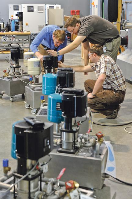 Grundfos Pumps Corp.'s North America engineers work on one of the company's water pumps.