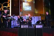A live band provides music for the casino opening.