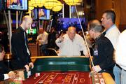 An opening-day guest plays craps at Hollywood Casino at Kansas Speedway.