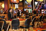 Dealers wait at gaming tables before the public floods in.
