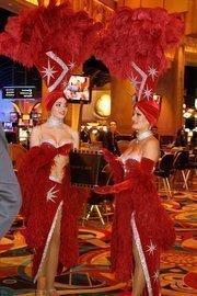 Showgirls prepare for the ribbon-cutting.