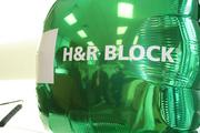 Tax preparers talk in the lobby of H&R Block's newest office in the Power & Light District.