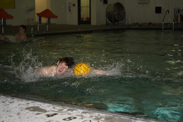 A Raytown swimmer runs a drill during practice last Friday.
