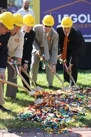 Officials scoop Legos at the groundbreaking of the $15 million Legoland Discovery Center in Kansas City.