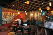 Chef Aarón Sánchez helped define the style of the interior of Mestizo. He says he wanted to differentiate it from people's typical idea of Mexican restaurants.