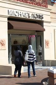 Handbag and clothing boutique Michael Kors opened Sept. 1 in retail space formerly occupied by Eddie Bauer on the Country Club Plaza. The store sells clothes and handbags by the store's namesake designer.