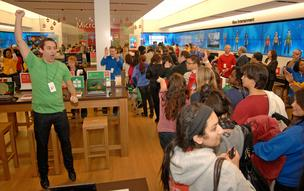 A Microsoft Store associate cheers at the November grand opening of the 14th Microsoft Store at Tysons Corner Center in McLean, Va. One of those stores will open soon at Oak Park Mall in Overland Park.
