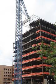 Workers finish raising the last steel beam for the Plaza Vista project in Kansas City.