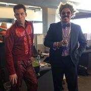 Saepio employee Sean Stratton (left), dressed as Derrick Zoolander, poses with employee Phil Broz, whose Don King costume won the costume contest.