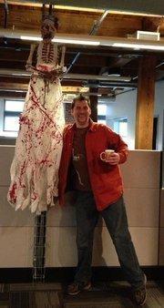 Saepio employee Jason Cotterell strikes a creepy pose during the company's Halloween party.