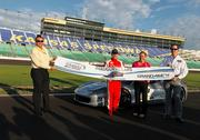 The Kansas Speedway holds a ribbon-cutting to open its new infield track. From left: Jeff Boerger, president, Kansas Speedway Development Corp.; Peter Carlino, chairman and CEO, Penn National Gaming Inc.; Lesa Kennedy, vice chairman and CEO, International Speedway Corp.; and Bob Sheldon, general manager, Hollywood Casino at Kansas Speedway.
