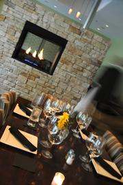 Tavern at Mission Farms' dining room features a stone-encased fireplace.