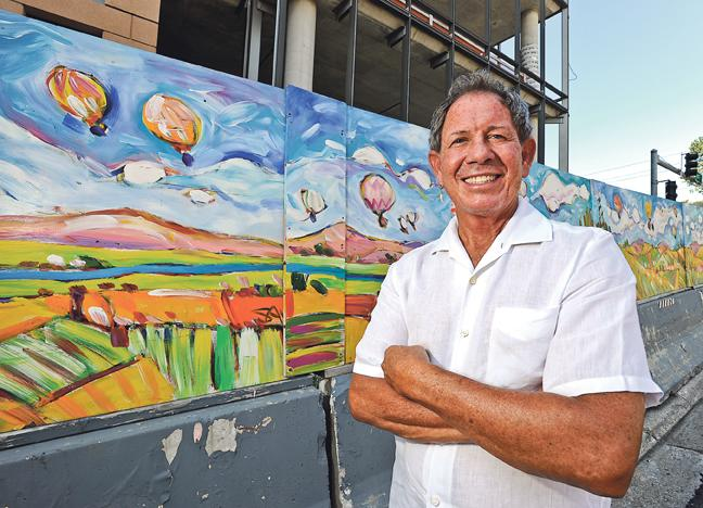 Jimmy Frantze, owner of JJ's Restaurant, survived years waiting for the West Edge construction (behind mural) to wrap up near his restaurant.
