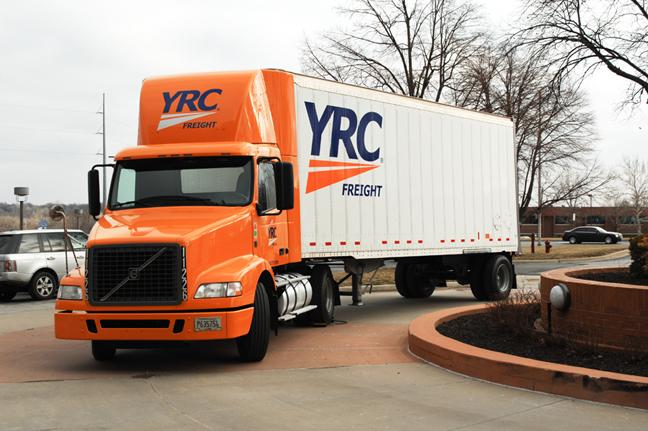 Overland Park-based YRC Worldwide Inc. trims its second-quarter loss despite a drop in freight for its national division.